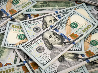 stacked dollar bills