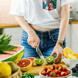woman slicing fruits
